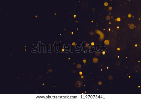 Dark Abstract Gold bokeh sparkle on black background #1197073441