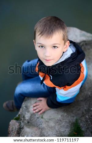 cute boy near the lake #119711197