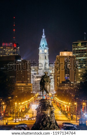 View of downtown Philadelphia, Pennsylvania at night from the Philadelphia Museum of Art with equestrian statue looking at the downtown