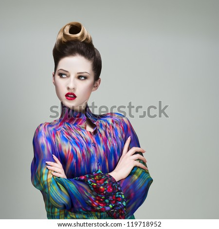 young fashionable beautiful woman face. makeup and hairstyle.  High quality image.