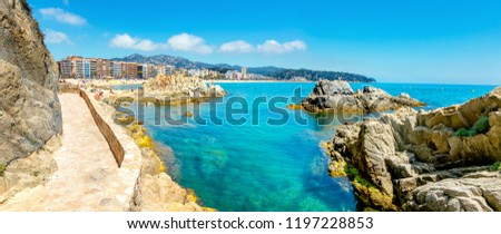 Landscape with rocky shore and beautiful view of seaside at Lloret de Mar resort town. Costa Brava, Catalonia, Spain #1197228853