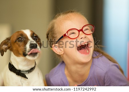 Beautiful girl with a Down syndrome with her pet Jack Russell Terrier #1197242992