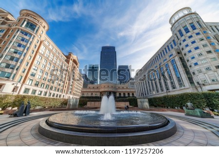 Architecture and features of Canary Wharf on a sunny autumnal morning. Canary Wharf is London's principal business district. #1197257206