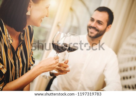 Young business people work on improving the taste of wine. Plans and projects to expand the winemaking #1197319783