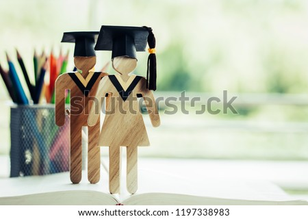 Back to School Concept, Two People Sign wood with Graduation celebrating cap on open textbook show alternative studying. Graduate or Education knowledge learning study abroad international Ideas. #1197338983