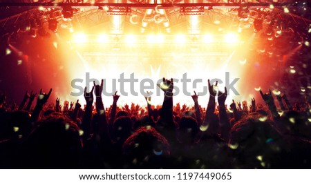 Concert arena with festive people #1197449065
