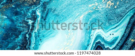 Abstract ocean- ART. Natural Luxury. Style incorporates the swirls of marble or the ripples of agate. Very beautiful blue paint with the addition of gold powder. #1197474028