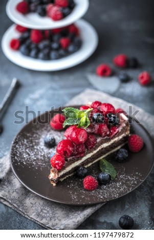 Portion of layered creamy fruit cake with in close up view #1197479872