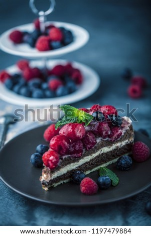 Portion of layered creamy fruit cake with in close up view #1197479884