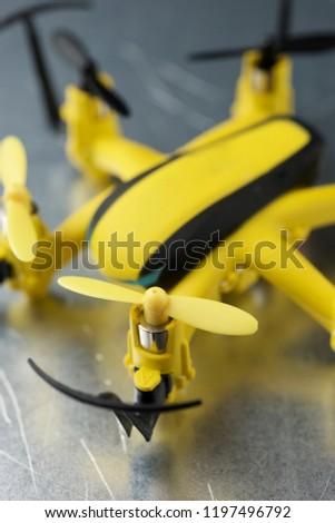 Yellow drone on a metal table. #1197496792