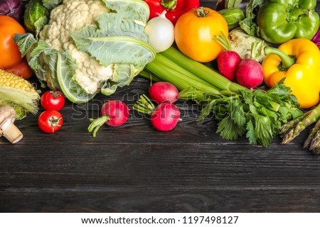Flat lay composition with assortment of fresh vegetables on wooden table. Space for text #1197498127