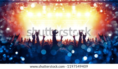 Concert arena with festive people #1197549409