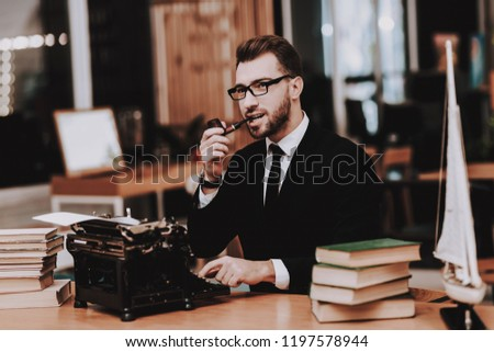 Eyeglasses. Businessman. Suit. Old Typewriter. Hands. Young Male. Working in Office. Creative Worker. Creates Ideas. Desk. Workplace. Project. Sit. Brainstorm. Work. Office. Inspiration. #1197578944