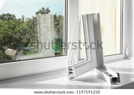Sample of modern window profile on sill. Space for text #1197591250