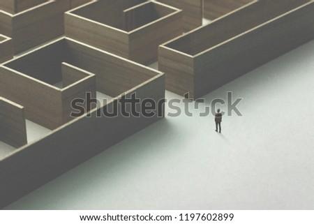 man entering wooden maze #1197602899