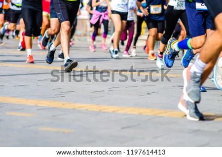 Marathon running race. Runners legs passing in motion.  #1197614413