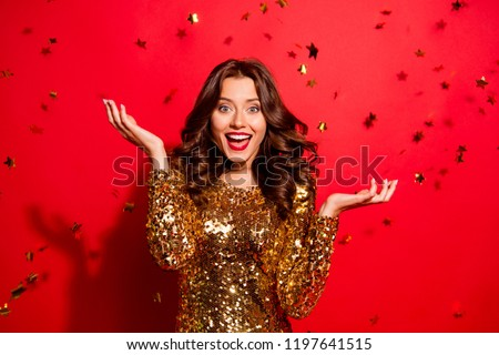 Careless, carefree, dream, dreamy concept. Beautiful, attractive, pretty, charming, modern wave hairstyle lady look at camera with raised hands up and open mouth isolated on shine red background #1197641515