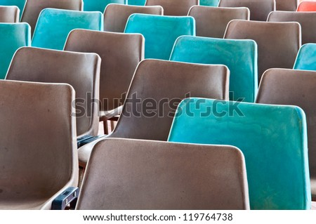 Grey and green old plastic chairs #119764738