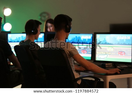 Young people playing video games at tournament #1197884572