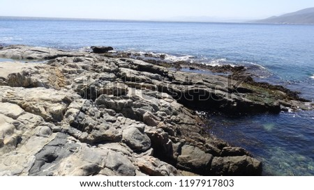 Landscape of rock formation and rocky beach #1197917803