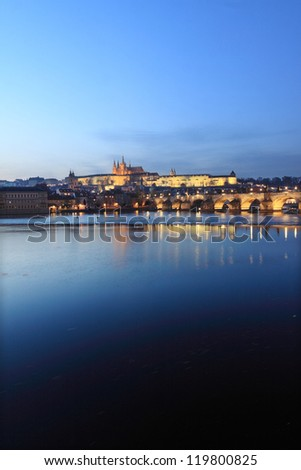 Colorful Prague gothic Castle above the River Vltava with Charles Bridge in the Night, Czech Republic #119800825