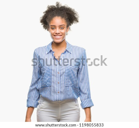 Young afro american woman over isolated background with a happy and cool smile on face. Lucky person. #1198055833