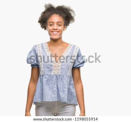 Young afro american woman over isolated background with a happy and cool smile on face. Lucky person. #1198055914