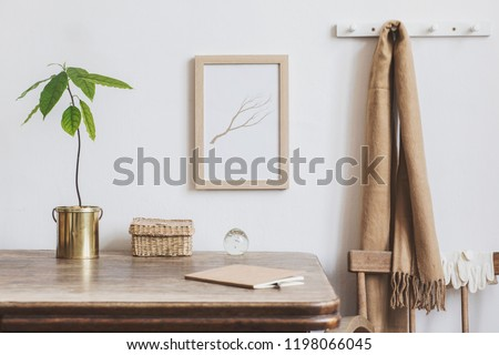 Vintage kitchen interior design with small table with mock up frame, straw boxes, avocado plant and notebooks. Minimalist interior. #1198066045