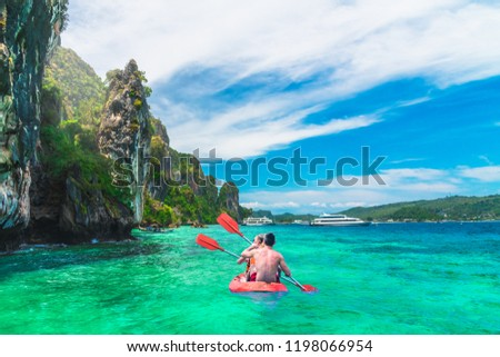 Beautiful nature scenic landscape of Phi Phi island Krabi with couple traveler joy fun kayaking, Travel adventure Phuket Thailand Tourism destination place Asia Tourist on summer holiday vacation trip #1198066954