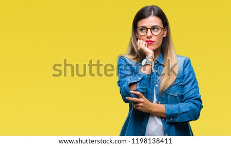 Young beautiful woman over wearing glasses over isolated background thinking looking tired and bored with depression problems with crossed arms. #1198138411