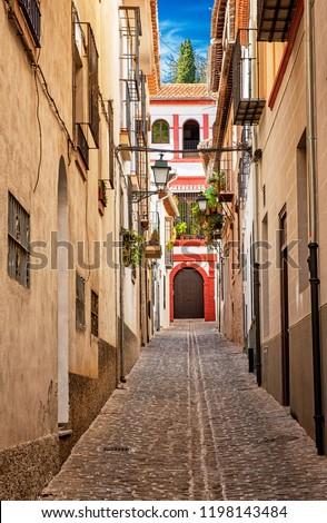 Narrow street in Granada, Spain #1198143484