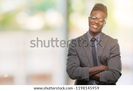 Young african american business man over isolated background happy face smiling with crossed arms looking at the camera. Positive person. #1198145959
