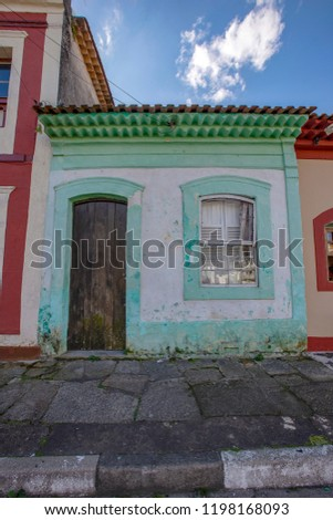 Colorful facade of house in Iguape, historic city of colonial period of Brazil #1198168093