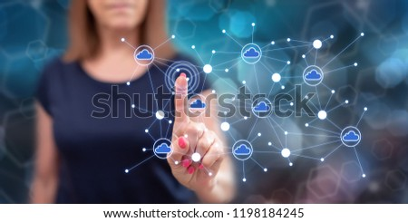 Woman touching a cloud networking on a touch screen with her finger #1198184245
