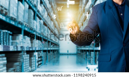 Businessman manager touching icon of logistics for workers with Modern Trade warehouse logistics. #1198240915