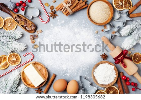 Ingredients for cooking christmas baking decorated with fir tree. Flour, brown sugar, eggs and spices top view. Bakery background. #1198305682