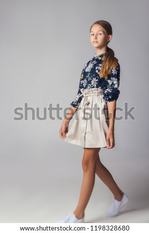 child in the Studio posing in fashionable clothes #1198328680