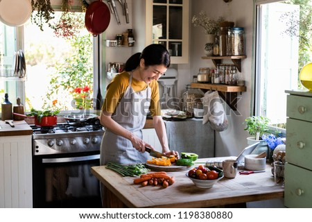 Japanese woman cooking in a countryside kitchen #1198380880