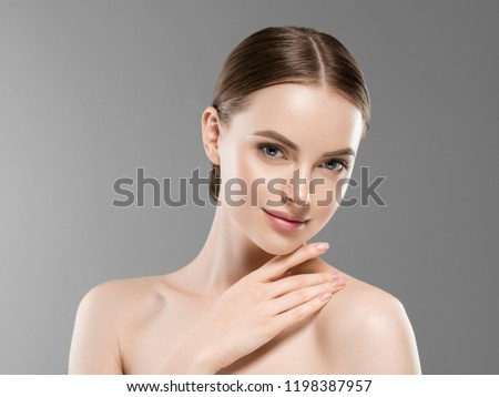 Healthy skin woman natural makeup beauty face closeup over gray background #1198387957