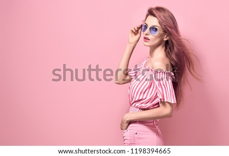 Portrait Sexy adorable fashion Lady in Stylish romantic Summer Outfit. Young Pretty Blonde Girl posing in Studio. Beautiful Model woman in Sunglasses, Trendy fashionable Hairstyle on Pink  #1198394665