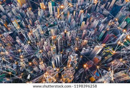 Digital network connection lines of Hong Kong Downtown. Financial district and business centers in smart city in technology concept. Top view of skyscraper and high-rise buildings. Aerial view #1198396258
