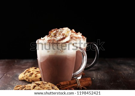 Hot chocolate cocoa with whipped cream on table