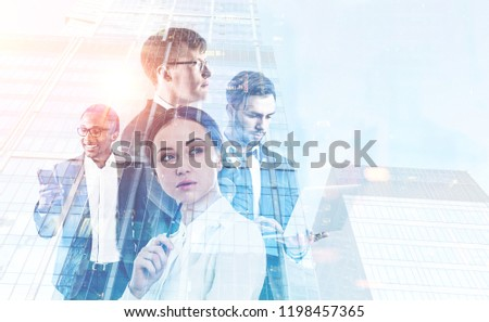 Diverse business team members with gadgets in morning city. Business lifestyle concept. Toned image mock up double exposure #1198457365