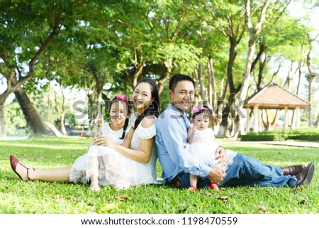 Happy Asian family #1198470559