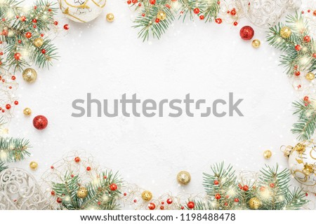 Christmas frame of spruce, red & gold christmas decorations on white background. Copy space. New Year lights. Flat lay. #1198488478