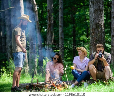 Camping and hiking. Company friends relaxing and having snack picnic nature background. Company hikers relaxing at picnic forest background. Spend great time on weekend. Take a break to have snack. #1198610110