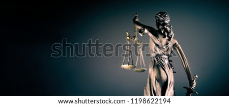 Statue of lady justice - rear view with copy space. Royalty-Free Stock Photo #1198622194
