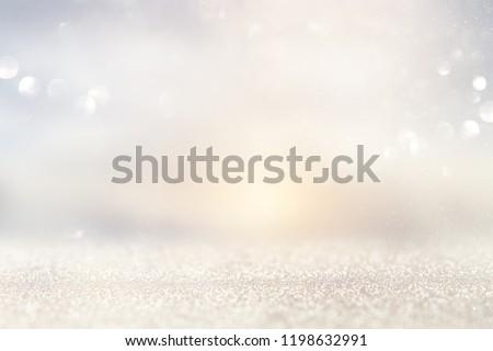 glitter vintage lights background. silver and light gold de-focused #1198632991