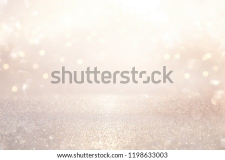 glitter vintage lights background. silver and light gold de-focused Royalty-Free Stock Photo #1198633003