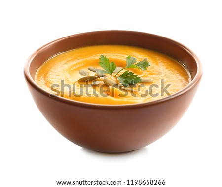 Delicious pumpkin cream soup in bowl on white background #1198658266